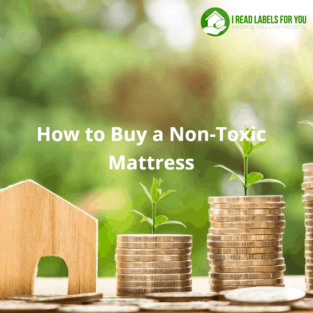 How to buy a non-toxic mattress organic. A picture of three stacks of coins and three stems of grass growing out of them.