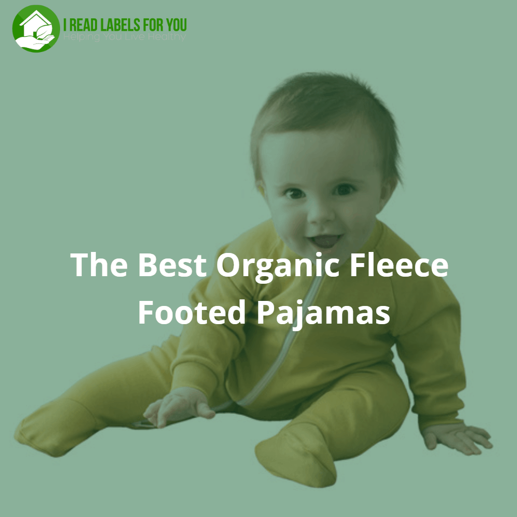 The Best Organic Fleece Footed Pajamas. A photo of a happy sitting baby dressed in yellow footed pajamas with a zipper.