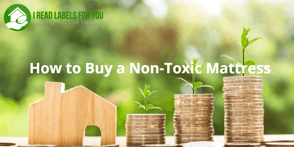 How to buy a non-toxic mattress. A picture of three stacks of coins and three stems of grass growing out of them.